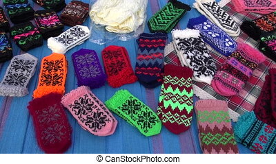 assorted handmade knitted mittens collection in autumn fair