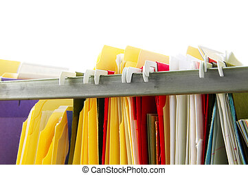Assorted hanging file folders on white background