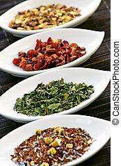 Assorted herbal wellness dry tea in bowls