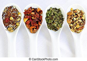 Assorted herbal wellness dry tea in spoons