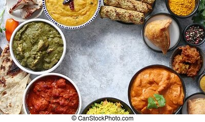 Assorted indian food on stone background. Dishes of indian...