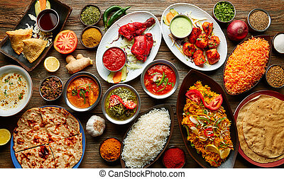 Assorted Indian recipes food various with spices and rice on...