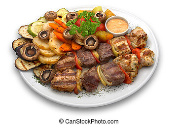 assorted kebab: veal, chicken and pork with grilled vegetables