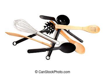 Assorted kitchen utensils on a white background