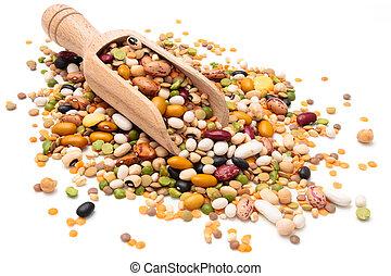 Assorted legumes. - Assorted legumes in wooden scoop....