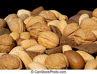 Assorted Nuts - Angled view of assorted nuts against black...