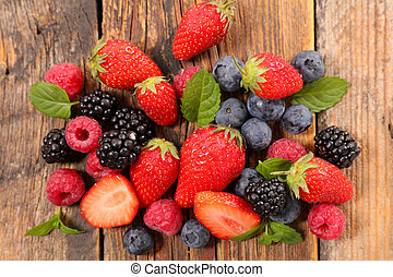 assorted of berries fruits on wood background