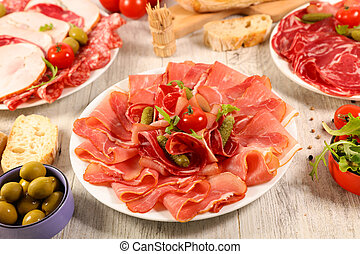 assorted of meat with bread