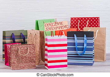 Assorted paper shopping bags.