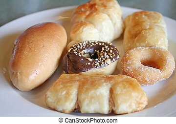 Various assorted pastries and donuts on a plate