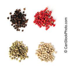 Assorted peppercorns - Heaps of assorted peppercorns on...