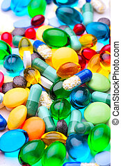 assorted pharmaceutical capsules and medication in different colors denoting different drugs and antibiotics in a health care concept