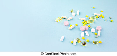 Assorted pharmaceutical medicine pills. Place for text.