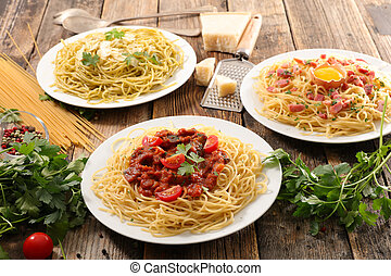 assorted plate of spaghetti and sauce