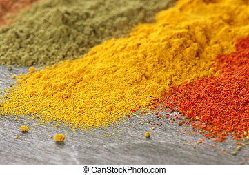 Assorted powder spices - Close-up of assorted loose powder ...