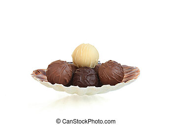 Assorted praline chocolate in a seashell