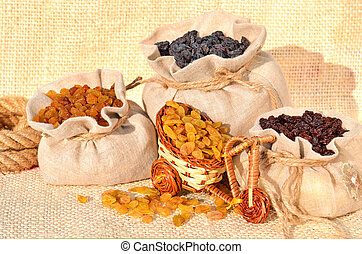 Assorted raisins in the bags on the sacking
