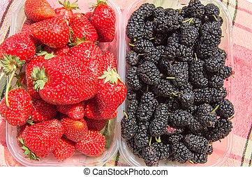 Assorted ripe strawberries and mulberry for a healthy diet