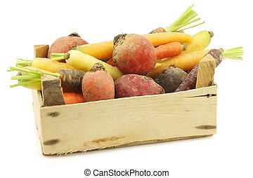 assorted root vegetables in a wooden crate