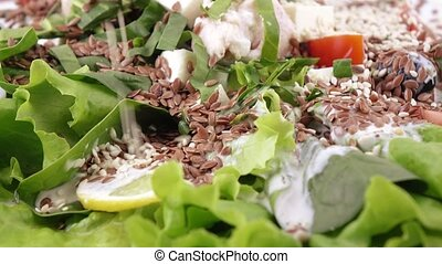 Assorted salad on lettuce leaves - Salad with chicken,...