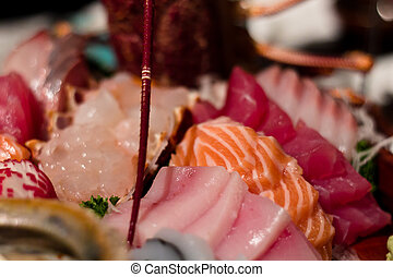 Assorted raw fish and lobster presented as a japanese cusine