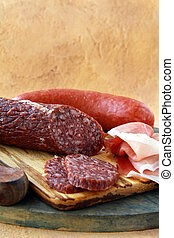 Assorted several kinds of sausages and smoked meats on a ...