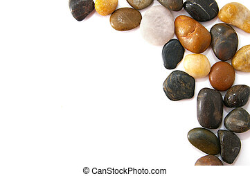 assorted smooth river stones in a border, on white