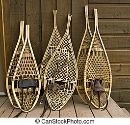 Assorted snowshoes - Traditional Canadian snowshoes, focus...