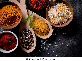 Assorted spices on stone background