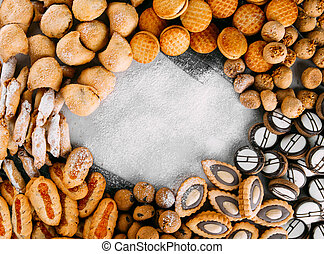Assorted sweet cookie frame background copy space