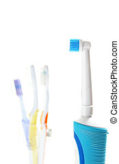 assorted tooth brushes on white background