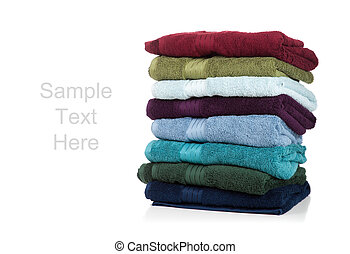 Assorted towels on white with copy space