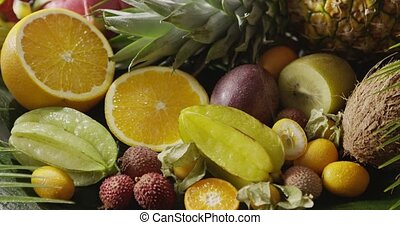 Assorted tropical fruits - halves of orange, pineapple,...