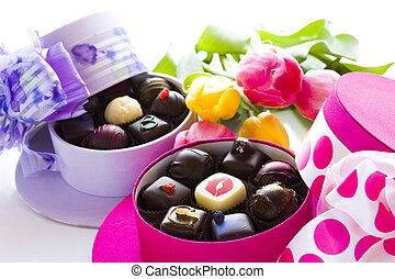 Assorted truffles in cute hat shape boxes for Mothers Day.