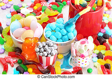 Assorted variety of sweet sugar candies includes, gummy bears, gum balls and sugar fruit slices.