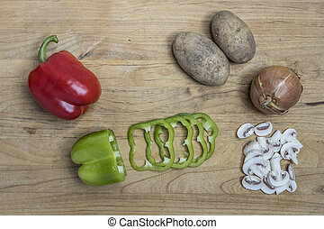 Assorted vegetables on a board.