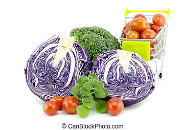 assorted vegetables, purple cabbage, cherry tomatoes on trolley, broccoli and mint isolated white background