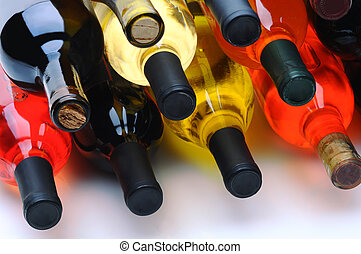 Assorted wine bottles on their side