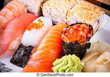 Assortment fish sushi with salmon ikura, close up