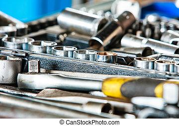 Assortment kit of adjustable metallic tools in mechanic...