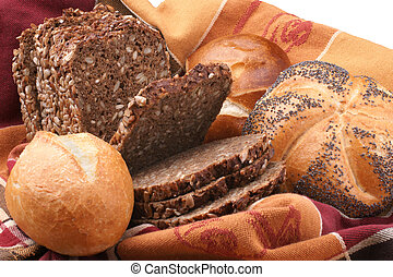 assortment of baked bread and rolls