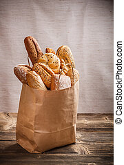 Assortment of baked goods packaged in a paper bag