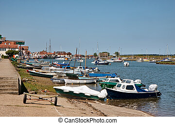 Assortment of boats moored at Wells Town harbour Norfolk
