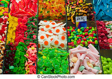Assortment of Candy at La Boqueria - A variety of candies in...
