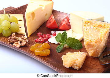 Assortment of cheese with fruits, grapes, nuts and cheese...