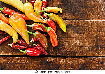 Assortment of chilli peppers on a rustic wooden table