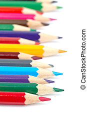 Assortment of coloured pencils with shadow on white ...