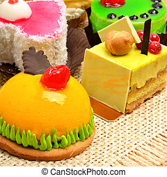 Assortment of delicious cakes, pies, tarts with fuits and cream