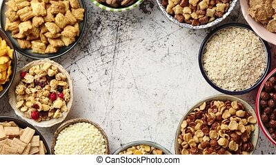 Assortment of different kinds cereals placed in ceramic...