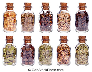 Assortment of different spices in glass bottles isolated on...